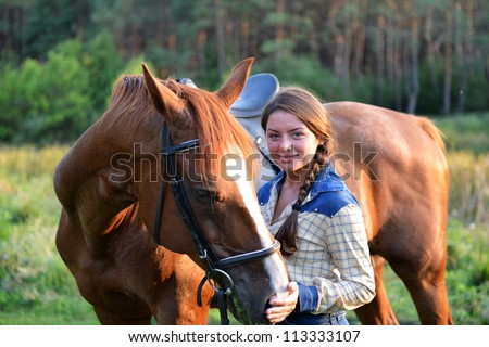 Beautiful girl on the forest with her horse. - stock photo