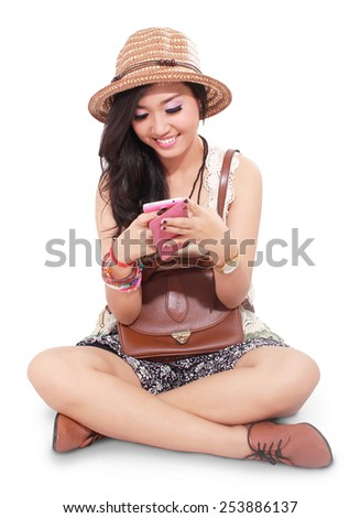 beautiful girl on vacation and playing mobile phone, isolated on white background - stock photo