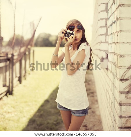 beautiful girl photographed in the old camera - stock photo