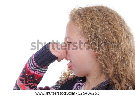 Beautiful girl pinches her nose - stock photo