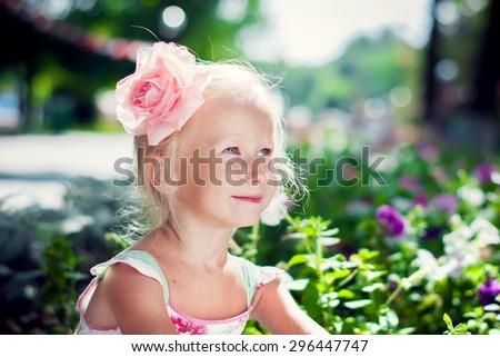 Beautiful Girl Playing in the Summer Garden - stock photo
