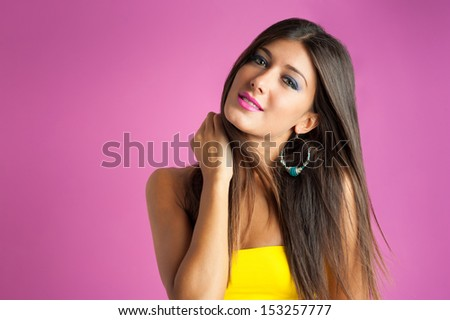 Beautiful girl portrait against pink background.  - stock photo