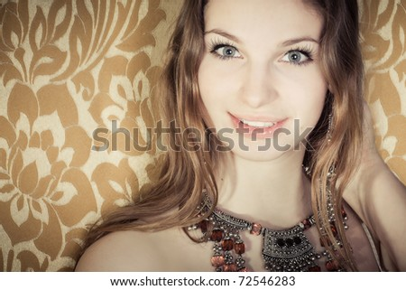 Beautiful girl portrait in golden colors - stock photo