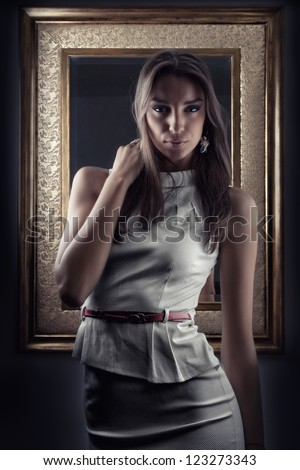 Beautiful girl posing in front of mirror - stock photo
