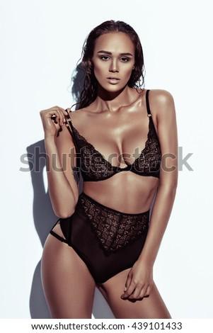 Beautiful girl posing in lingerie. Studio, shooting, editorial, fashion, posing, emotions, linen, bra, bikini, body, sexy - stock photo