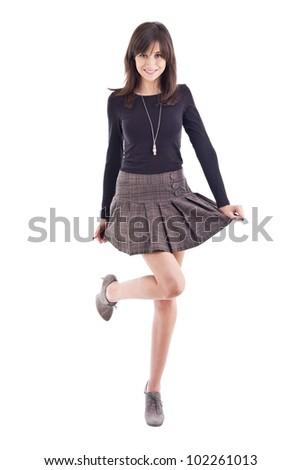 Beautiful girl posing in short skirt. Isolated over white background - stock photo