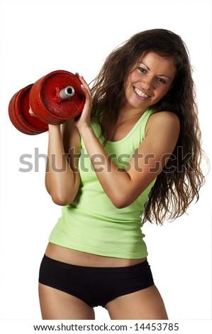 beautiful girl raises dumbbell - stock photo