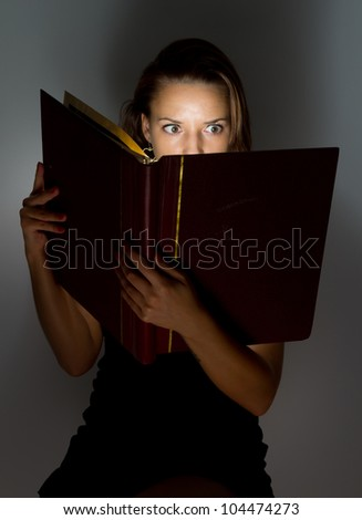 Beautiful girl reading a book. - stock photo