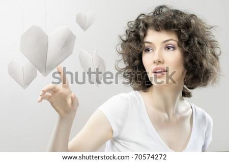 beautiful girl regard to the large heart - stock photo