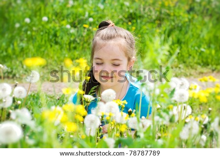 Beautiful girl relax on the meadow - stock photo