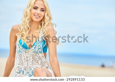 Beautiful girl relaxing and smiling outdoor at summer beach - stock photo