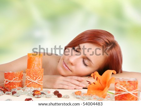 beautiful girl relaxing in spa salon - stock photo
