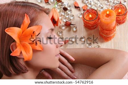 beautiful girl relaxing in spa salon - stock photo