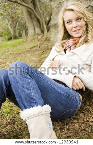 beautiful girl relaxing in the park - stock photo