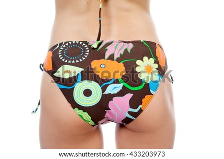 Beautiful girl sexy brunette girl posing in a swimsuit on a white background isolated - stock photo