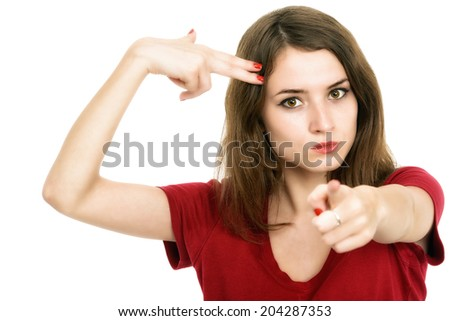 Beautiful girl shooting at her head with hand gun - stock photo