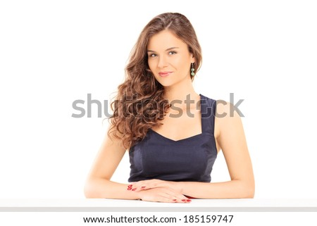 Beautiful girl sitting at a table isolated on white background - stock photo