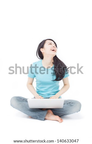 beautiful girl sitting on the floor with laptop computer, isolated on white background - stock photo