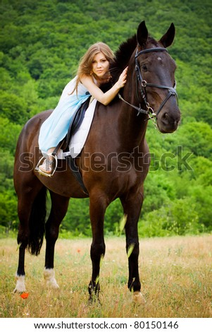 beautiful girl sitting on the horse - stock photo