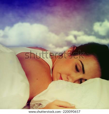 Beautiful girl sleeps in the bedroom. - stock photo