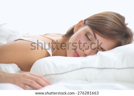 Beautiful girl sleeps in the bedroom, lying on bed. - stock photo