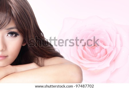 Beautiful Girl smile face close up with pink rose background, model is a asian beauty - stock photo
