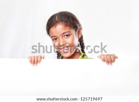beautiful girl smiling holding a large piece of paper in her hands - stock photo