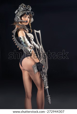 Beautiful girl - soldier of the future - stock photo