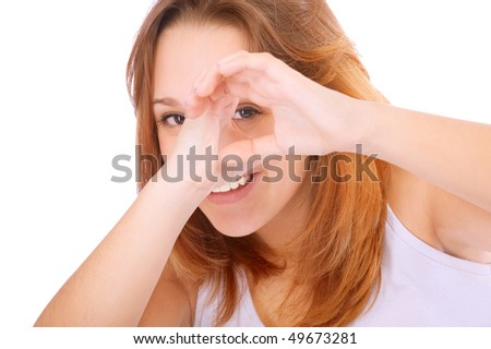 Beautiful girl spies through hands, isolated on white background. - stock photo