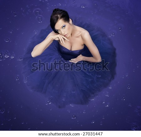 Beautiful girl standing in a big container - color version - stock photo
