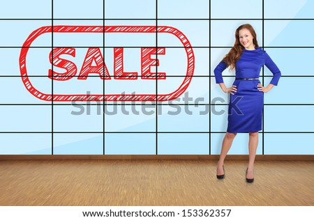 beautiful girl standing in office with big plasma wall - stock photo