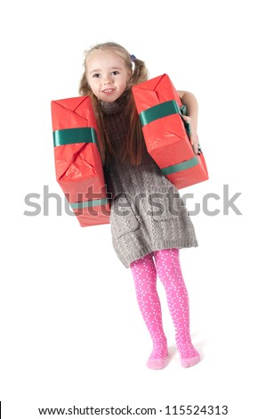 Beautiful girl standing with christmas presents on white - stock photo