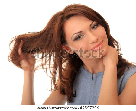 Beautiful girl straightens her hair with his hand. - stock photo
