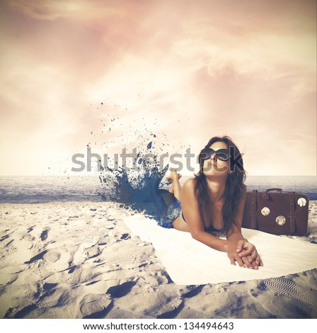 Beautiful girl sunbathing at the beach - stock photo
