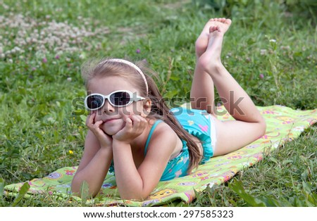 beautiful girl sunbathing on the sun - stock photo