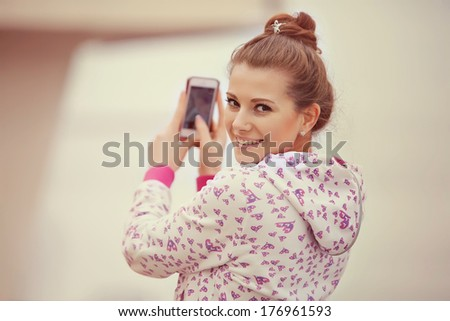 Beautiful girl taken pictures of her self - stock photo
