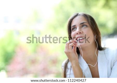 Beautiful girl talking with smartphone handsfree device - stock photo