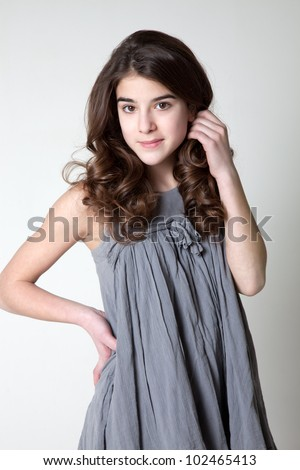 Beautiful girl Teen in curlers - stock photo