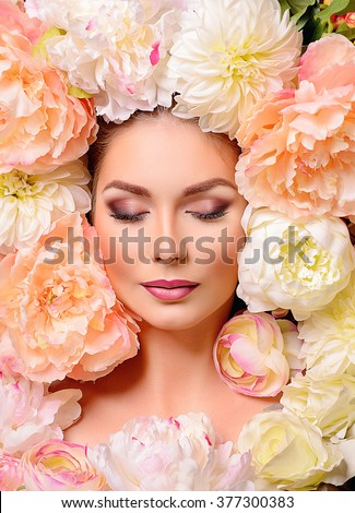Beautiful girl.the beautiful girl in flowers.woman riddle.woman spring.woman flower.the girl from the magazine.girl supermodel.portrait of the glamourous girl.beauty.Miss World.fashionable make-up. - stock photo