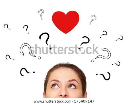 Beautiful girl thinking about love with many questions and heart above head isolated on white - stock photo