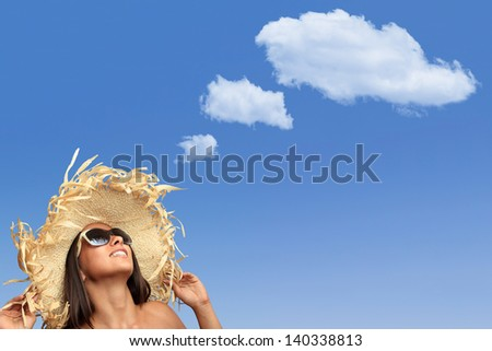 beautiful girl thinks something with white cloud ( copy space ) on the sky - stock photo