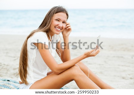 beautiful girl using mobile phone device on the beach , wireless technology  - stock photo