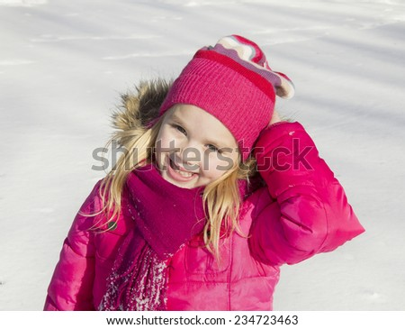 beautiful girl walking in winter forest and smiling - stock photo