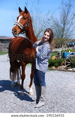 Beautiful girl walking with horse on nature background - stock photo
