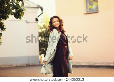 beautiful girl walks among houses - stock photo