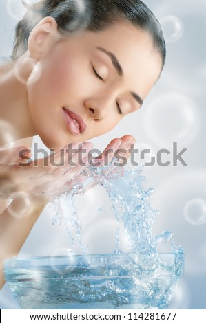beautiful girl washes his face - stock photo