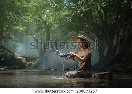 Beautiful Girl Washing on brook - stock photo