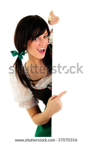 Beautiful Girl Wearing A Traditional Costume For Oktoberfest And St Patrick's Day Holding A Blank Sign With Copy Space - stock photo