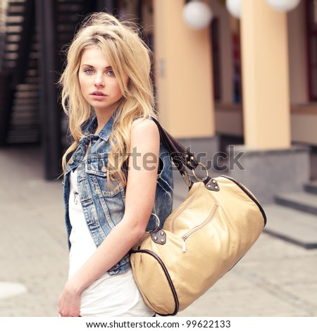 beautiful girl with a bag - stock photo