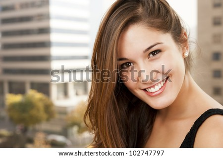 Beautiful girl with a beautiful face is smiling at the lens. - stock photo